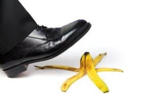 man's foot about to slip on banana peel
